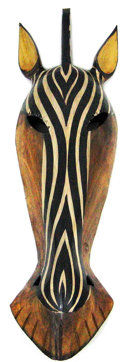 A CARVED TRIBAL MASK picks up on the stripes of the zebra canvas print and will also harmonise with the wooden bed and bedside table. Zebra wooden_face_wall_mask_1.jpg (540×1517)