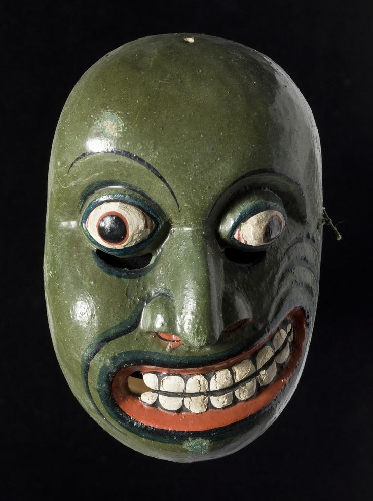 Mask used in the Sinhalese mask play Yakun-Natanava, made of Kaduru wood painted green, red and white, the front elaborately worked while the back is left crudely finished, representing a Sanni demon and used in mask dances to avert or exorcise disease: Sri Lanka