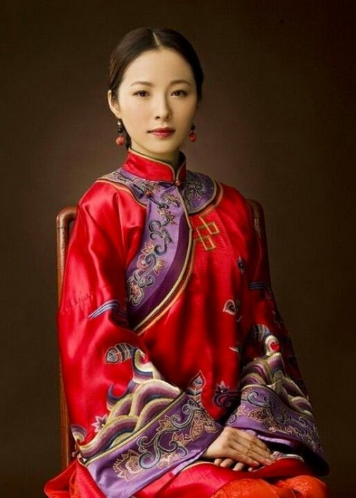 This is a photo of a traditional Chinese wedding dress. Colors can have strong cultural connotations. While white is the customary color for the bride in Western culture, in China white is associated with death and is avoided in wedding celebration (Reading on Color). Red and gold are often used in Chinese wedding dress as they signify good luck in Chinese culture (Reading on Color). Source: Pinterest