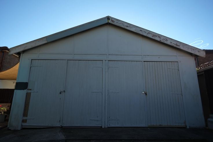 Shed with barn doors red brick building exterior garage for Building a brick garage