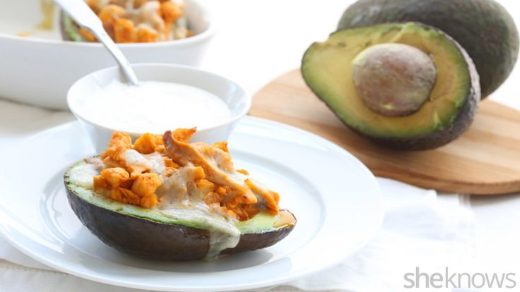 Baked avocados stuffed with Buffalo chicken bring tons of tangy flavor to dinner