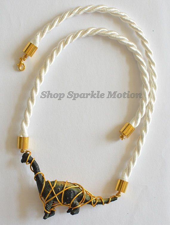 White and Gold Brachiosaurus Dinosaur Wire Wrap Necklace  https://www.etsy.com/uk/listing/188800686/white-and-gold-brachiosaurus-dinosaur?ref=shop_home_active_23