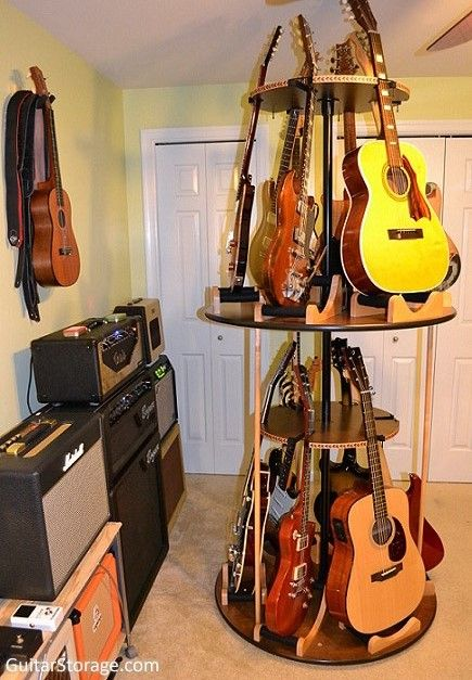 This mancave stays organized thanks to this rotating multiple #guitar stand that fits 12 guitars in only 3 feet of space! See it at https://guitarstorage.com/multiple-guitar-stands/