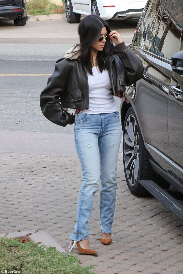 Lady in leather: Kourtney Kardashian, 38, seemed to be in a joyful mood as she picked up lunch with her boyfriend Younes Bendjima, 24, in Malibu on Saturday afternoon