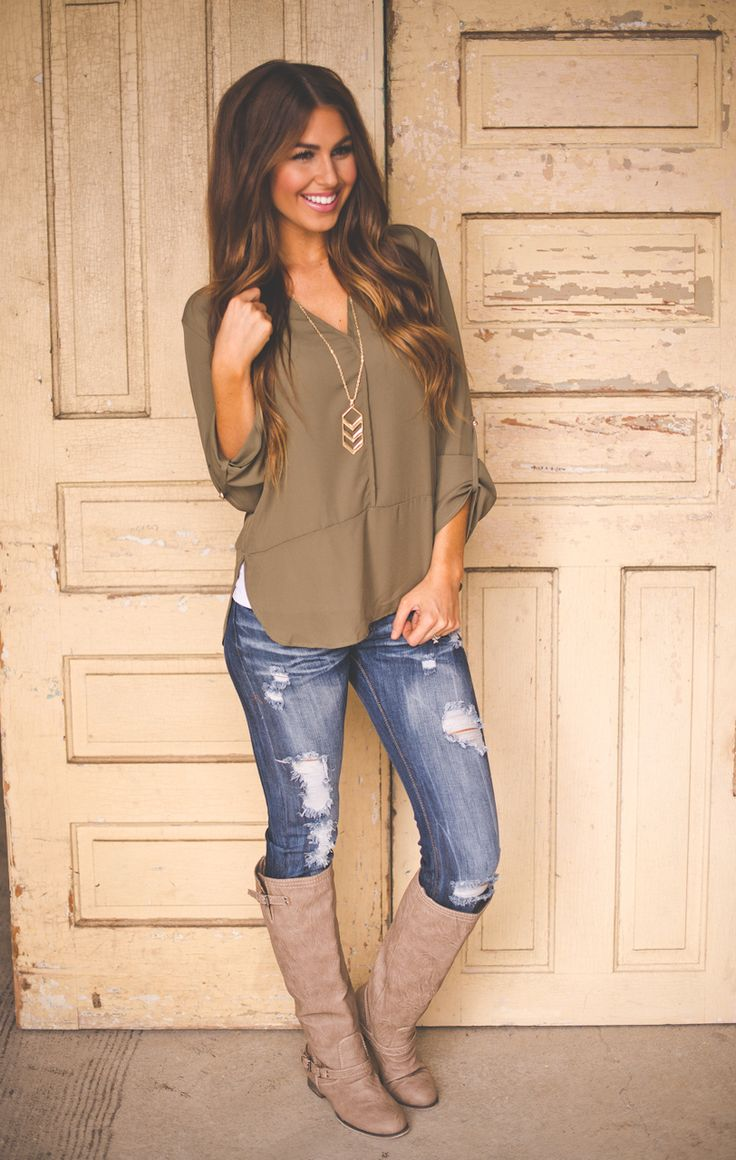 LOVE these jeans. The color and extreme distressed. Love the style of the blouse too.