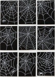 Spiderwebs, thanks to white paint markers on black card stock paper. Match made in heaven! #Sharpie #spiderweb