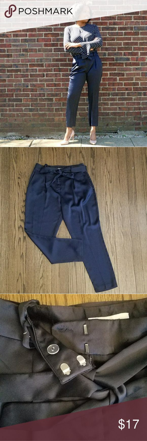 "Navy Faux Silk Trousers no damage 100% polyester  silk fabric feel Navy waist approximately 15"" inseam about 25"" ankle approximately 6""  length 36"" has pockets Primark Pants Ankle & Cropped"