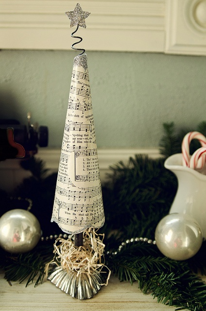 Book paper tree: Christmas tree made of old music paper and vintage tart tins