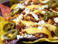 Pulled Pork Nachos...  I make Pulled Pork Sandwiches and a few days later we use the leftovers for nachos. It's perfect for everyone! This recipe also has a homemade cheese sauce that I would love to try!