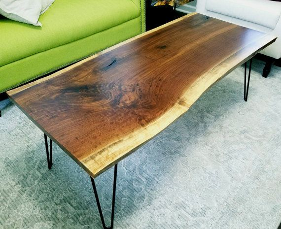 Hand crafted coffee table made from reclaimed Detroit black walnut. The city of Detroit is coming back, and as the city progresses I take the lumber which would otherwise end up as mulch or firewood and turn it into handcrafted furniture. The lumber I use comes primarily from trees that had to be cut down for new buildings, power lines, roads etc. All of the wood I use comes from the Southeast Michigan Urban Wood Project. Urban and reclaimed lumber is often very rough cut and I take the time…