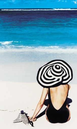 Beachside chic, black one piece and an oversized striped hat. So easy! xoSocialite