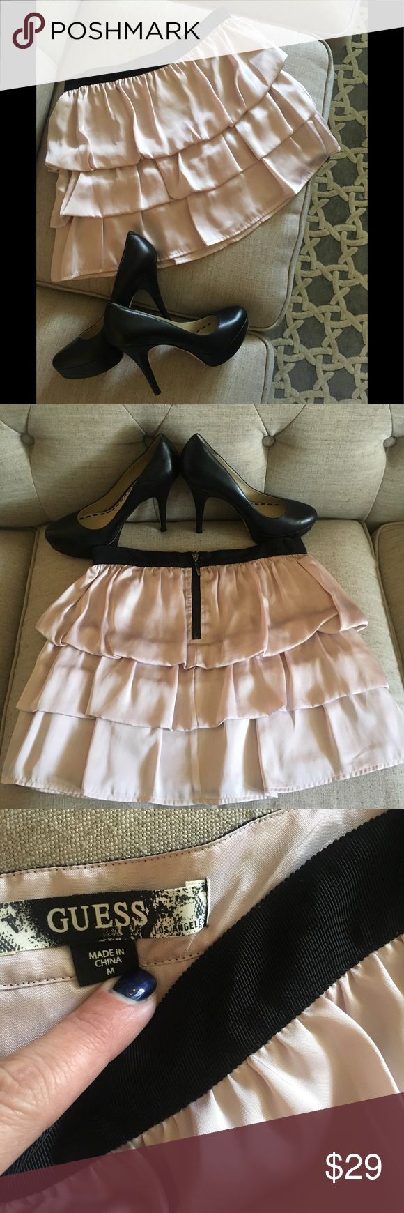 Pink ruffle mini skirt 💕 Pretty in pink 💕 Simply the cutest skirt ever!!! The fabric is super soft and it looks adorable on. Size medium made by guess. Cute for holidays! The color is pink!!! I tried to show it in the last picture! Guess Skirts Mini