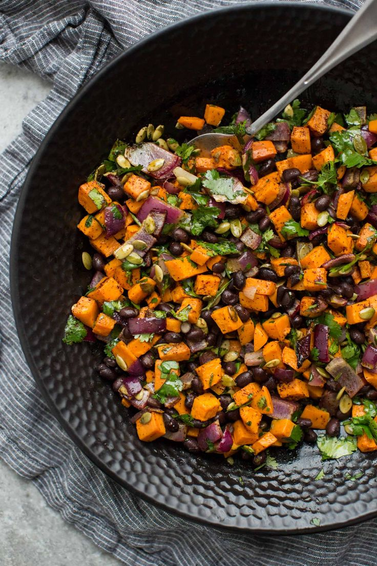An easy gluten-free/vegan black bean salad with roasted sweet potatoes, pepitas, and fresh cilantro. Perfect as a side or the start of a hearty meal.