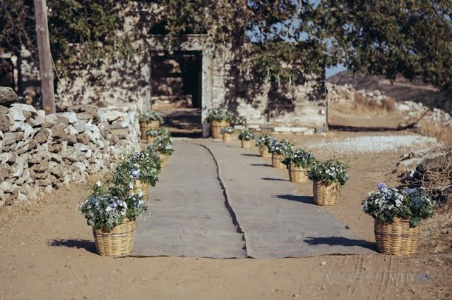 the event company Naxos wedding - Church entrance with traditional baskets and wild flowers