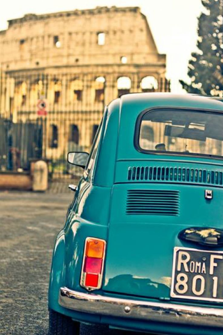 Fiat signature italian car in front of the colosseum rome