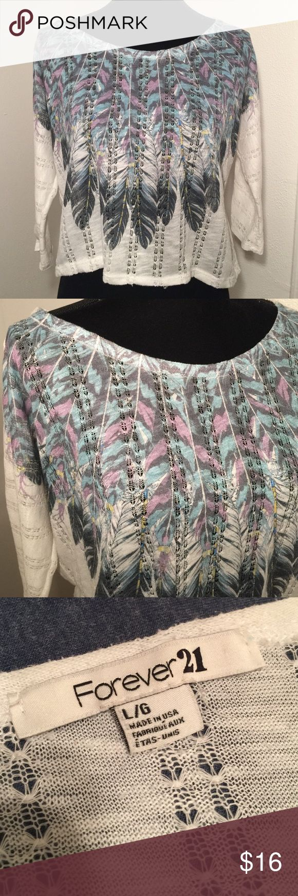 Forever 21 large feather crop top Forever 21 large feather crop top. Bust measures approximately 24 inches. Shoulder to hem measures approximately 21 inches. See-through and Lacey, very delicate, you would need to wear a tank top or Cami underneath. Forever 21 Tops Crop Tops