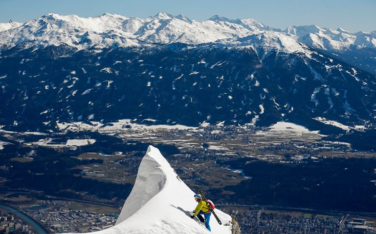 A skier climbs up to the summit of Seegrube mountain above the western Austrian city of Innsbruck