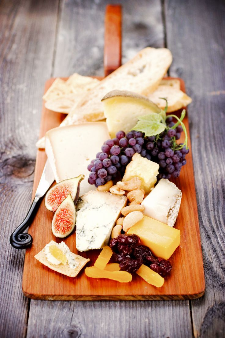 Picnic on a wooden table with a cheese platter