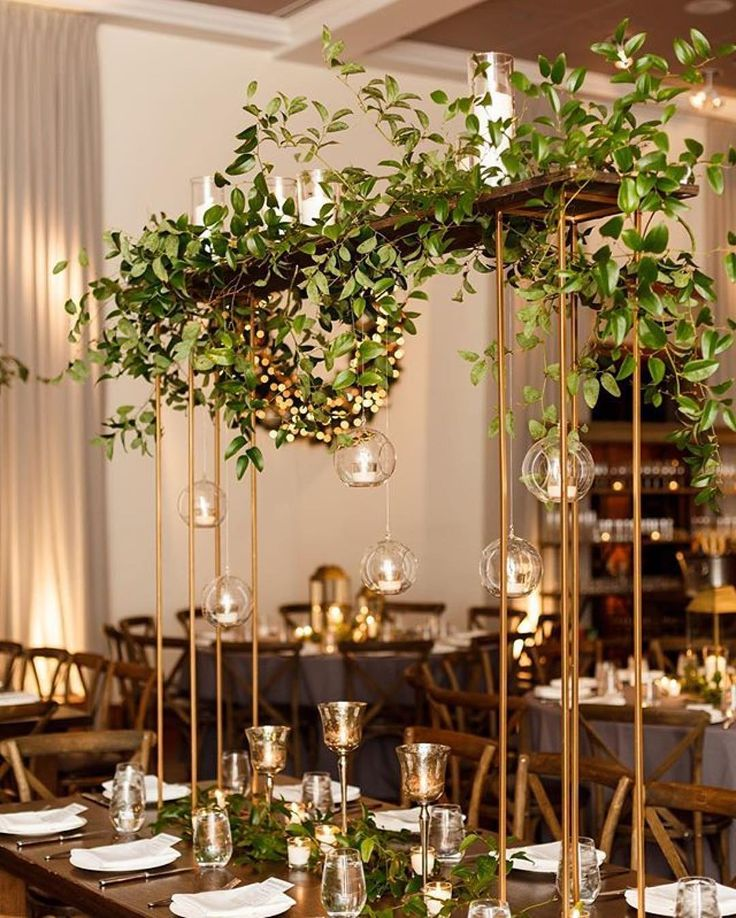 Modern Gold Centerpiece with Glass Orbs & Greenery | Photo: Kathleen Virginia Photography.