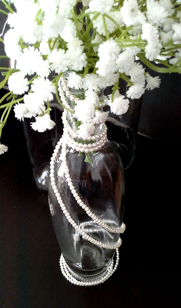 wine bottle, babies breath and pearl centerpieces for a vintage themed wedding; design & décor by Davis Floral Creations