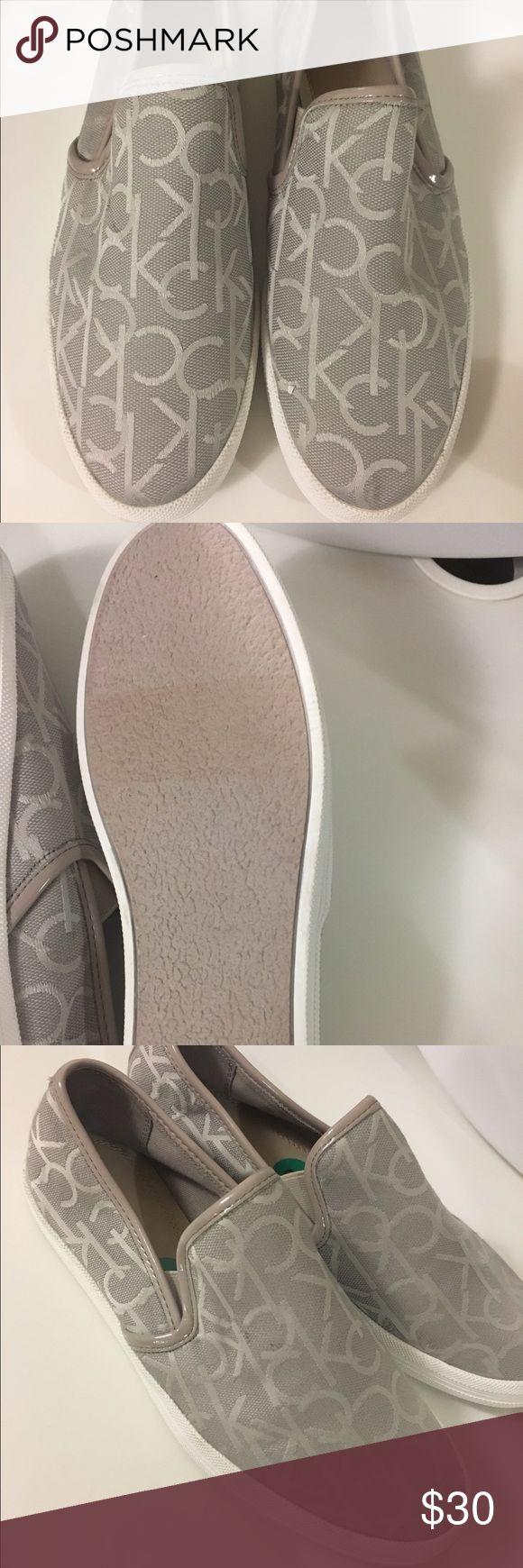 Calvin Klein sneakers Beige Calvin Klein slip on sneakers. Brand new, never been worn. Size US 8 Calvin Klein Shoes Sneakers