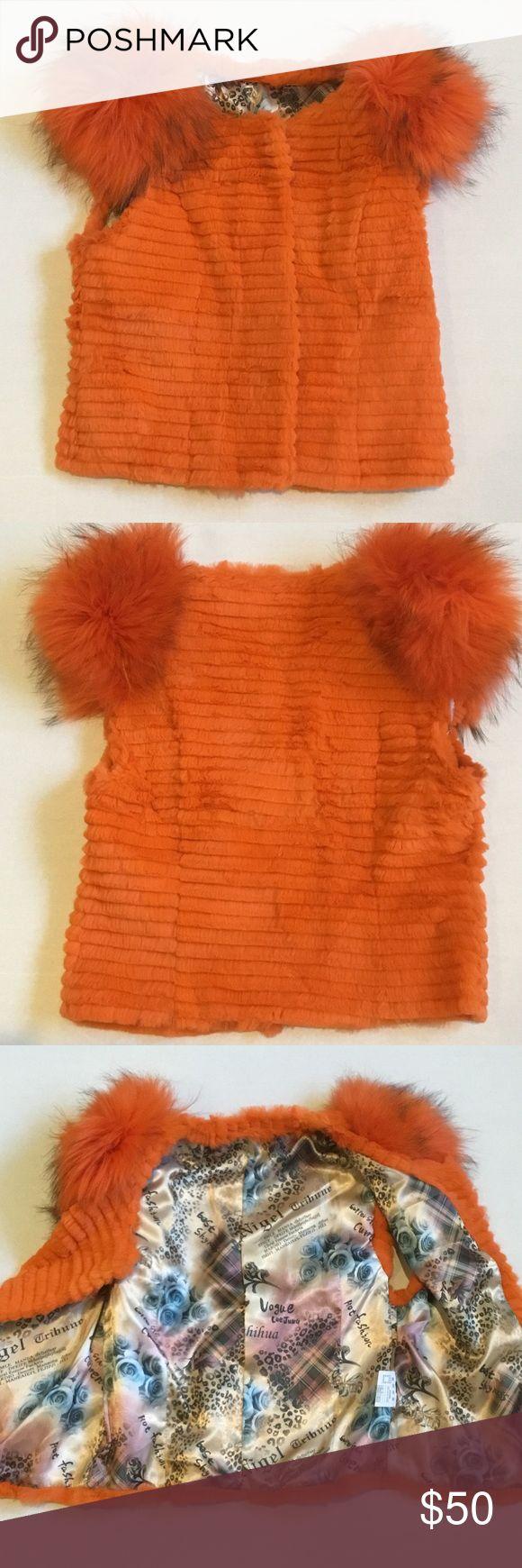 Orange rabbit fur vest with raccoon fur shoulders Orange sheared/trimmed rabbit fur vest with ombré or black streaked raccoon fur shoulders. Lined. Vintage. Super fun. Jackets & Coats Vests