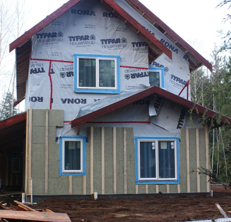 Roxul mineral wool panels measure 2 ft. by 4 ft. The insulation panels were attached to the wall with 2 1/2-inch cap nails, and were further secured by vertical furring strips screwed through the insulation into the studs.