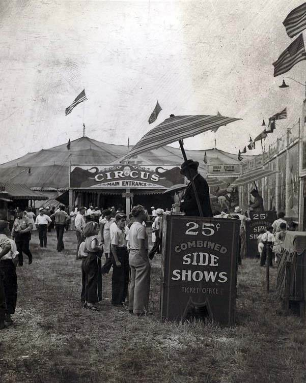 The next tier is the carnival side-show.  Freaks, carousel, strong man, etc.  Only the midgets pass between and are part of both if they play clowns.