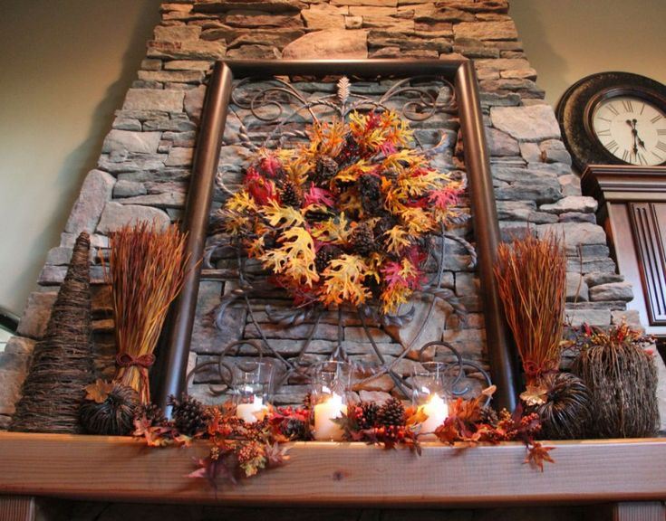 fall branches and pine cones some glass candle holders iron work fall mantel decoration of Delightful Fall Mantel Decorations