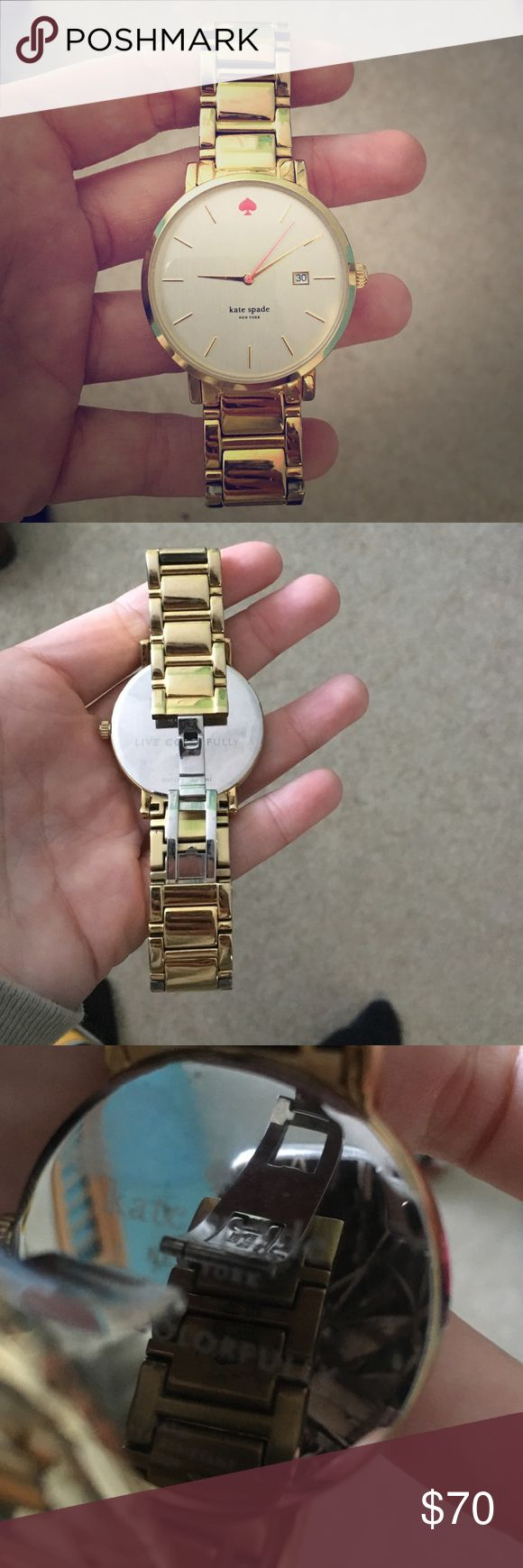 Kate Spade gold watch The watch stopped working, may need a new battery. Gold in color with pink spade. I have a small-med sized wrist. kate spade Accessories Watches