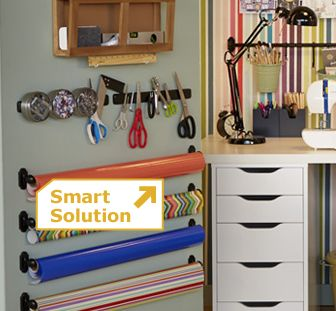 A magnetic strip-usually for knives in the kitchen- to hold scissors, pins, and other metal supplies!!  {20 Crafty Workspace   Storage Ideas from Ikea}