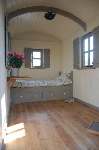 A Plankbridge Classic shepherd's hut with shepherd's bed