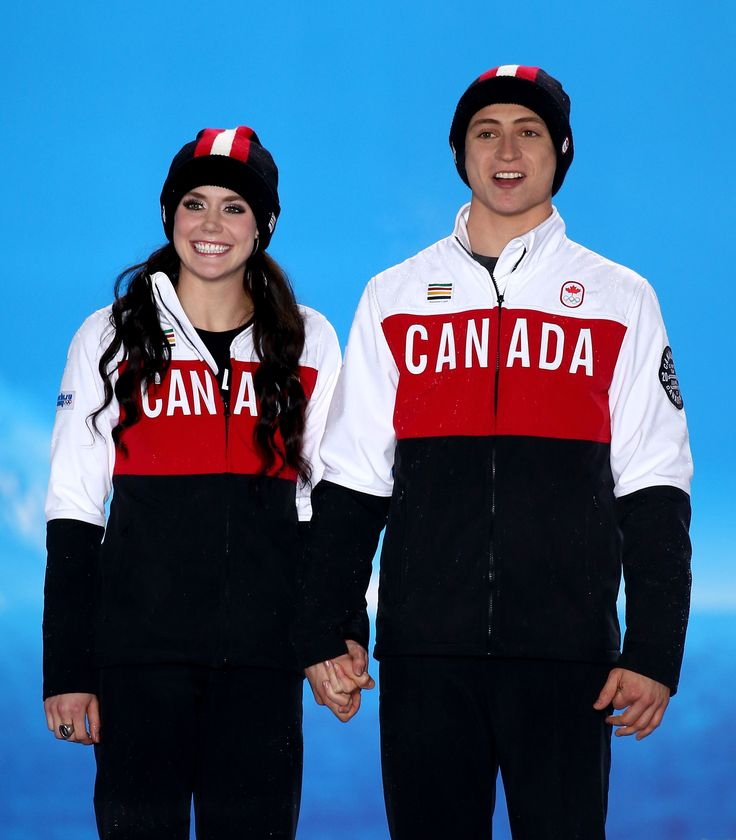 Silver medalists Tessa Virtue (L) and Scott Moir of Canada celebrate on the podium during the medal ceremony for the Figure Skating Ice Dance (c) Getty Images