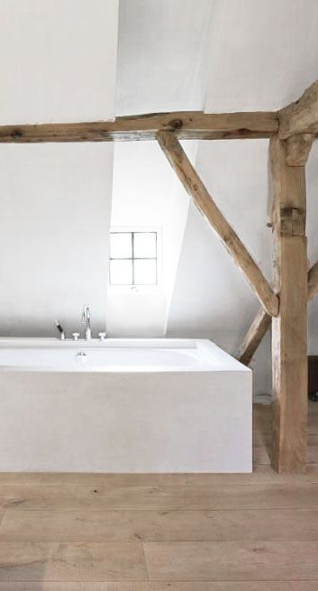 = white bath and wood beams