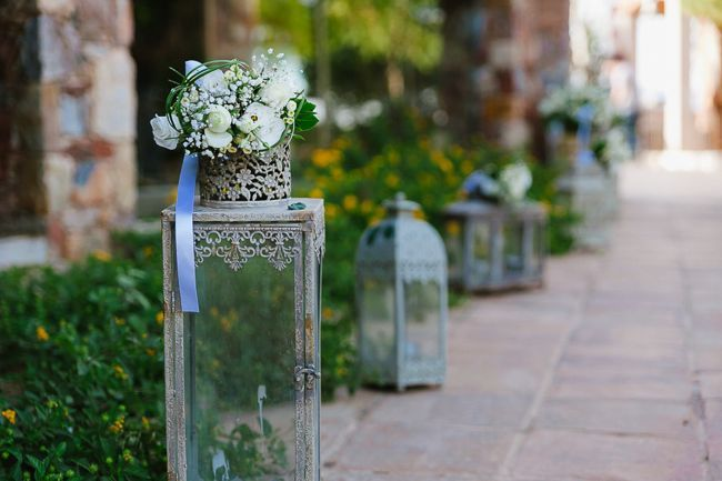 Line your wedding aisle with rustic lanterns | See more on http://www.youmeantheworldtome.co.uk/real-wedding-rustic-chic-wedding-in-greece/ Photography by Elias Kordelakos http://eliaskordelakos.com/en/