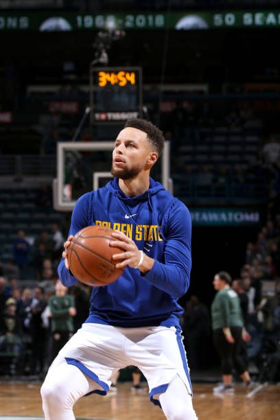 Stephen Curry of the Golden State Warriors warms up before the game against the Milwaukee Bucks on January 12 2018 at the BMO Harris Bradley Center...