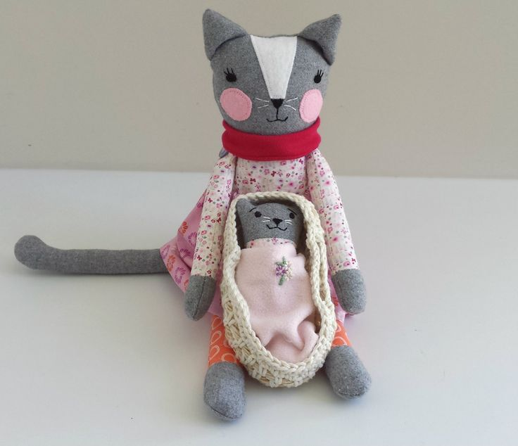 This one of a kind handmade cat doll is named Clarissa.She measures approximately 43 cm (16.5 inches) tall from tip of her ears to toes.She has a baby kitten (approx 15 cm or 5.5 inch tall) with a fluffy tail that likes to sleep in her Moses basket.Clarissa wears a removable elasticated skirt and scarf.Clarissa is great for encouraging imaginary play and is great to cuddle and hold.Because Clarissa has button jointed arms, she is suitable for children over the age of 4 y...