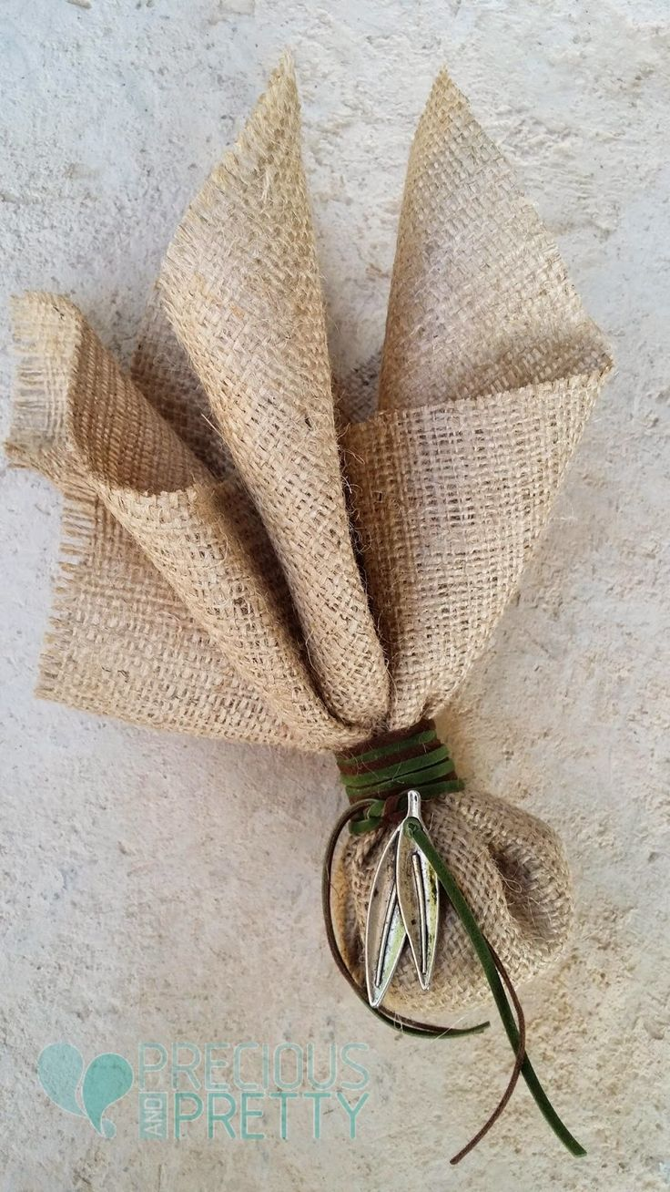 Burlap wedding favors with vintage olive leaves.