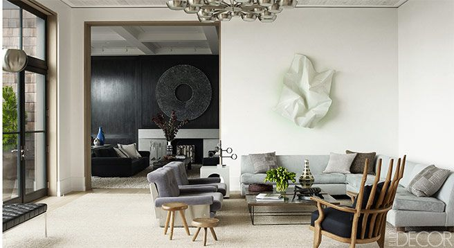 In this living room, the custom-made sofa is upholstered in an Edelman leather.