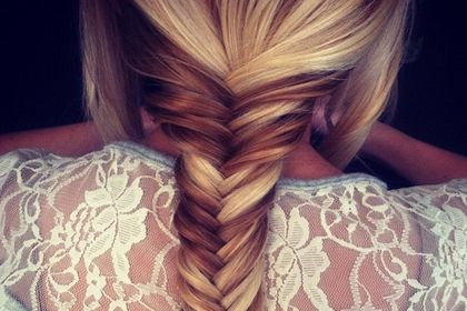 Low bun with a side braid, 5 Low Bun Hairstyles for Spring