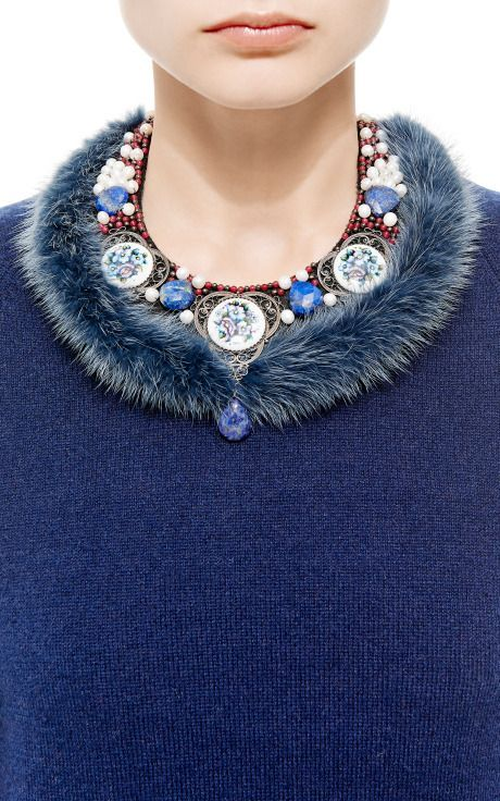 Masterpeace incorporates traditional elements of Russian culture into their statement accessories. This stunning necklace channels the decadence of Russian Tsars with a bold bib silhouette decorated in hand-painted enamel, stunning glass beading, and regal fur trim. Fur, enamel, beads Made in Russia