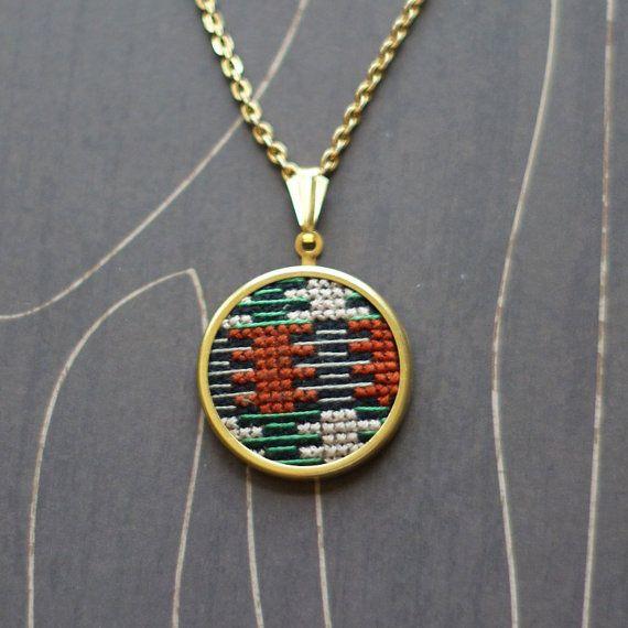 Modern geometric cross stitch necklace/ pendant emerald, rust on gold via Etsy