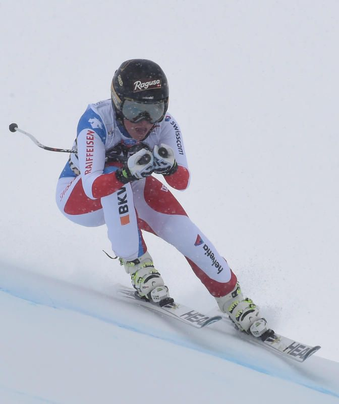 March 17, 2016 - Overall champion Lara Gut overtakes Lindsey Vonn to win super-G title - Switzerland's Lara Gut speeds down the course during the Women's Downhill Competition at the Alpine Ski World Cup Finals in St. Moritz, Switzerland on March 16, 2016. (AP Photo/Pier Marco Tacca)    Boston Herald