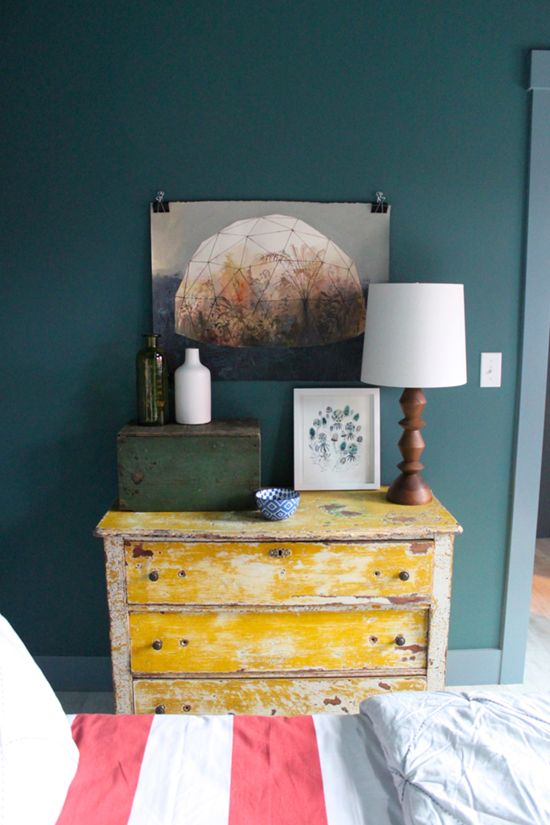 sunset mag seabrook brian paquette master bedroom, refinished yellow chest furniture, rustic style, green walls