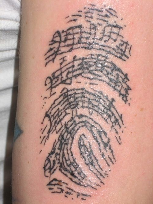 finger print tattoo with intermingled music notes. would be cool to do
