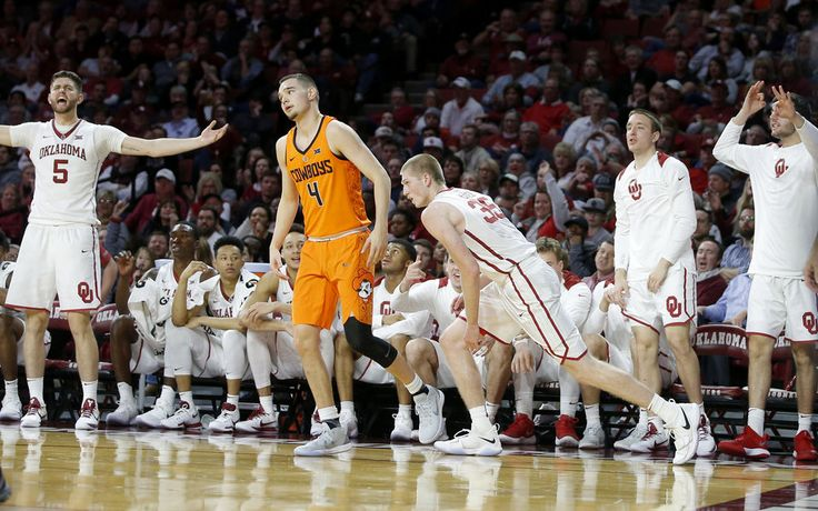 the Oklahoma bench celebrates after Oklahoma's Brady Manek (35) made a 3-pointer beside Oklahoma State's Thomas Dziagwa (4) during a Bedlam basketball game between the Oklahoma Sooners (OU) and the Oklahoma State Cowboys (OSU) at Lloyd Noble Center in Norman, Okla., Wednesday, Jan. 3, 2018. Photo by Bryan Terry, The Oklahoman