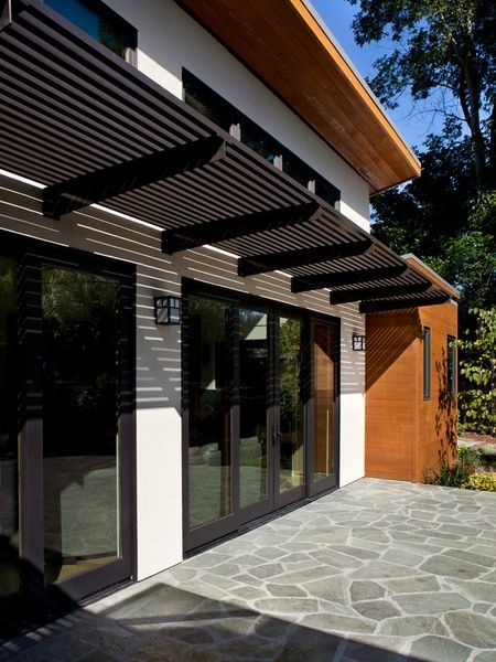 metal entry door awnings | Dark Metal Awning Over Patio Doors