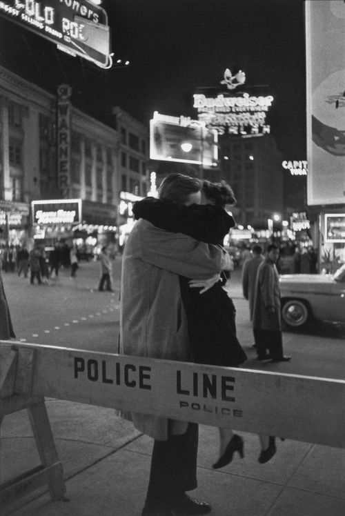 A couple kissing in Times Square, New York City, New Year's Eve, 1959. Photo by Henri Cartier-Bresson.