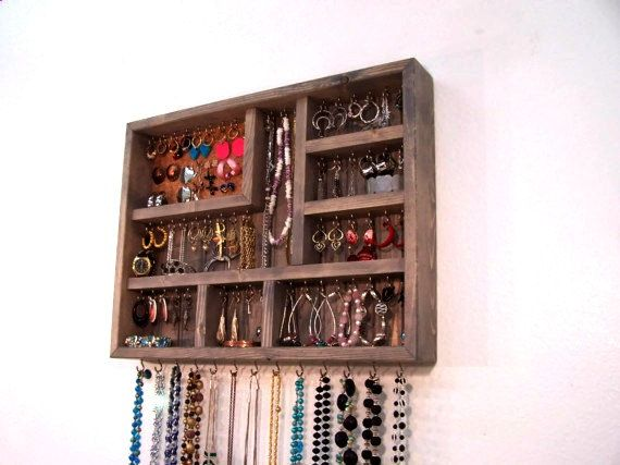 Jewelry organizer. Made in USA. The seller is really nice and works with you for custom orders/discounts. Just ordered this one unfinished and can't wait to hang it up.