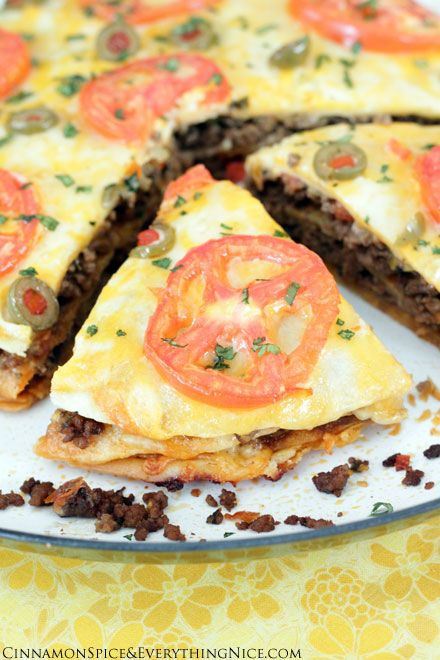 Taco Tortilla Lasagna - gooey layers of seasoned meat, tortillas and melted cheese.